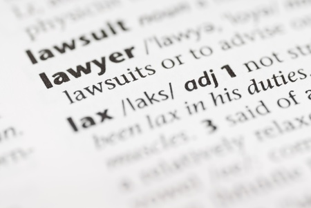 lawsuit: Macro image of dictionary word: Lawer, and pencil. Stock Photo