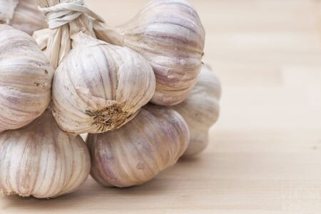 Macro image of garlic against wooden background