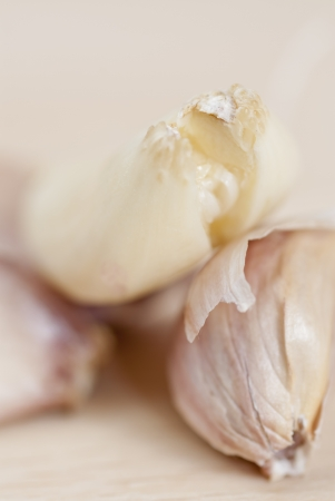 Garlic cloves on wooden surface; Macro.