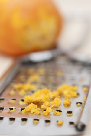 Grater and citrus zest on wooden kitchen surface. Stock Photo - 16724827