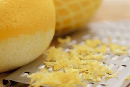 Zested lemons on wooden chopping board. Stock Photo - 16953291