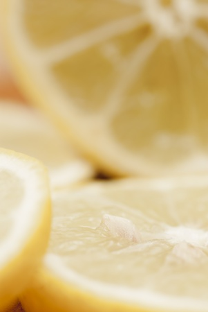 Cross section of sliced lemon on chopping board. Stock Photo - 16953732