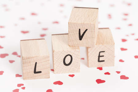 fondness: The word love constructed out ouf wooden blocks.