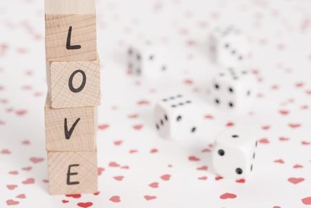 romance strategies: The word love alongside white dice