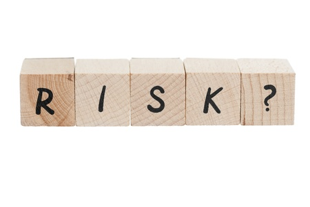 Risk with question mark written with wooden blocks