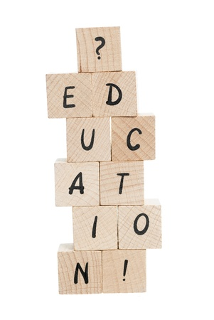 pronunciation: Education spelled out with wooden blocks and exclamation mark.