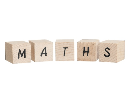 Maths written with wooden blocks  White background  Stock Photo - 18004405