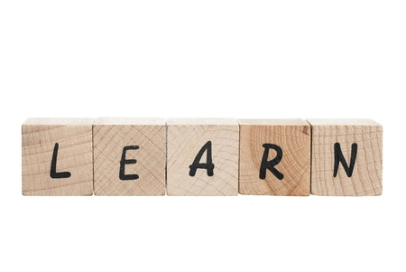 english text: Learn spelled out with wooden blocks  White background