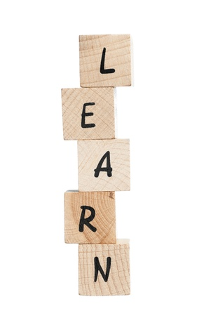 Learn spelled out with wooden blocks  White background  photo