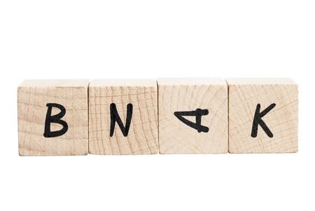 Bank misspelled with wooden blocks  White background Stock Photo - 18004446