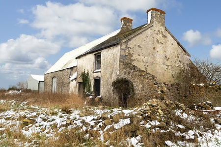 Derict farm building in South Wales, UK. Snow on ground. Stock Photo