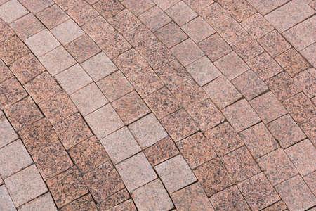 Granite cobblestoned pavement background. Natural stone textured background. Foto de archivo