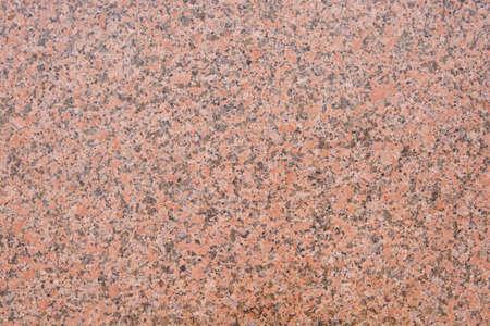 Dark pink granite texture with black splashes. A natural stone