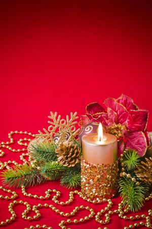 Candles with Christmas decorations photo
