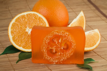 handmade soap: Natural orange soap manual manufactures against juicy fresh fruits of an orange Stock Photo