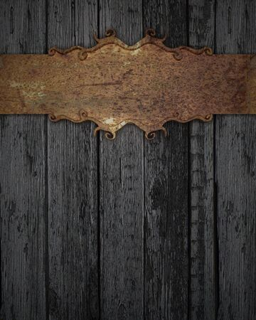 rusty plaque on a wooden texture photo
