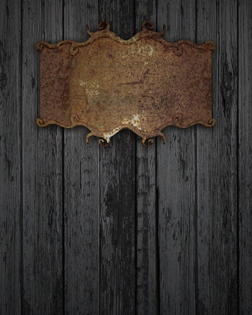 rusty plaque on a wooden texture Stock Photo - 12839565
