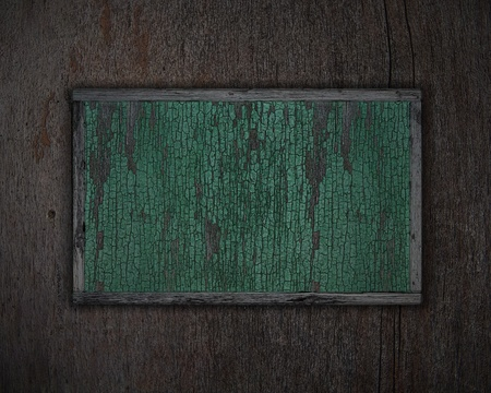 an old poster on wooden background photo