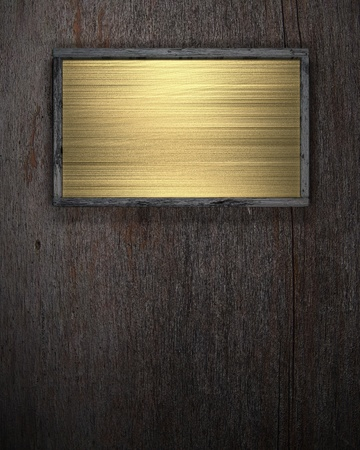 the gold plate on a wooden background photo