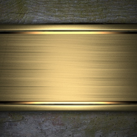 nameplate: gold strip on a wooden background Stock Photo