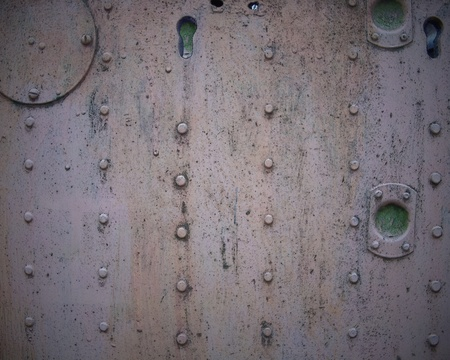 Metal wall with studs photo