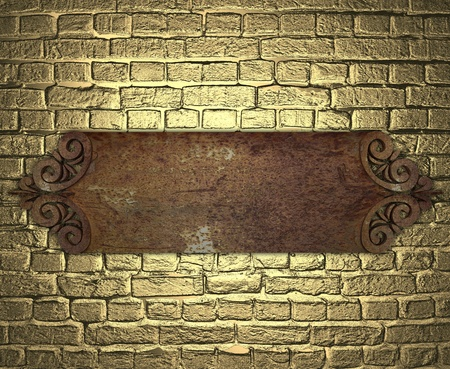 metal plate on brick golden wall photo
