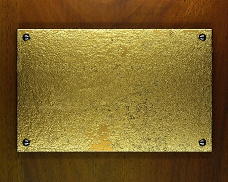 gold metal plate on wooden background Stock Photo