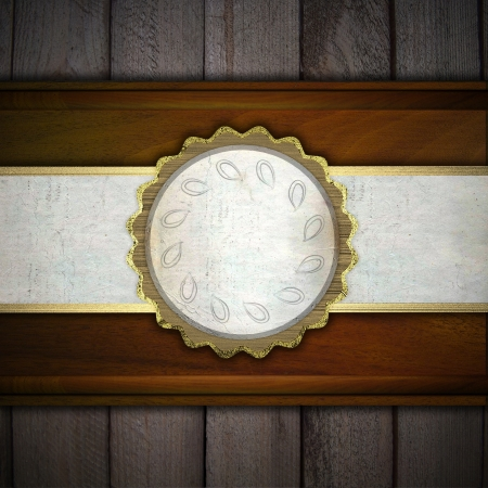 Wooden background with a white stripe and a golden circle photo