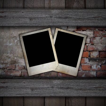 old photos on a brick background photo