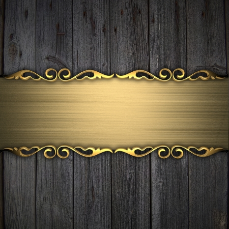 Beautiful pattern on a gold plate on a wood background Stock Photo - 14124799