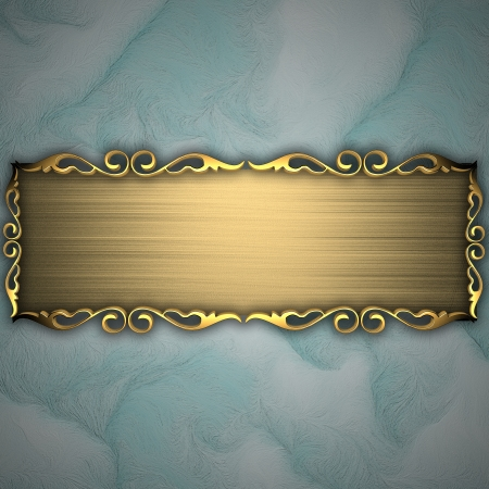 Beautiful pattern on a gold plate on a blue background photo