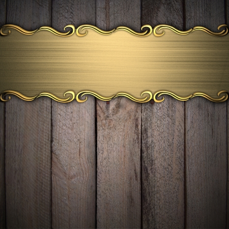 wood plaque: Beautiful pattern on a gold plate on a wood background Stock Photo