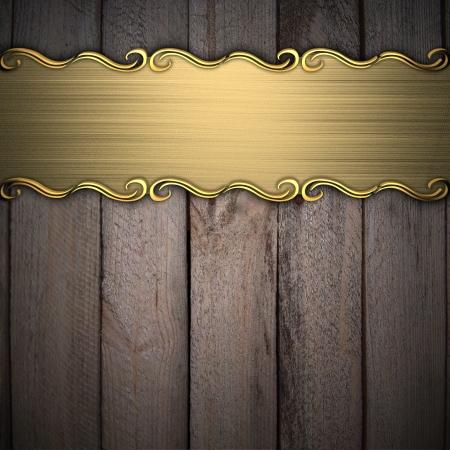 placa bacteriana: Patrón de belleza en una placa de oro sobre un fondo de madera