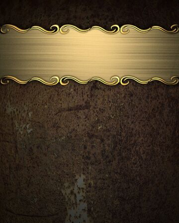 Beautiful pattern on a gold plate on a rust background