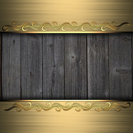 Beautiful pattern on a gold plate on a wood background Stock Photo - 14124461