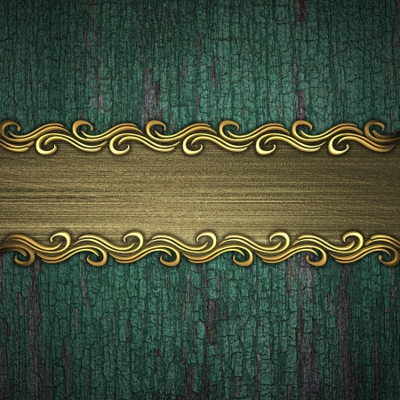Beautiful pattern on a gold plate on a wood background photo