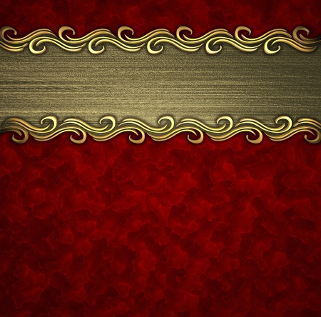 Beautiful pattern on a gold plate on a red background