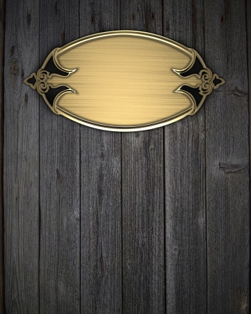 Beautiful frame on a gold nameplate on a wood background photo
