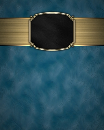 Gold Pattern on a black plate on a blue background photo