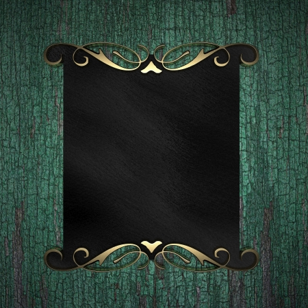 Wood Background with Black plate and a beautiful gold trim photo
