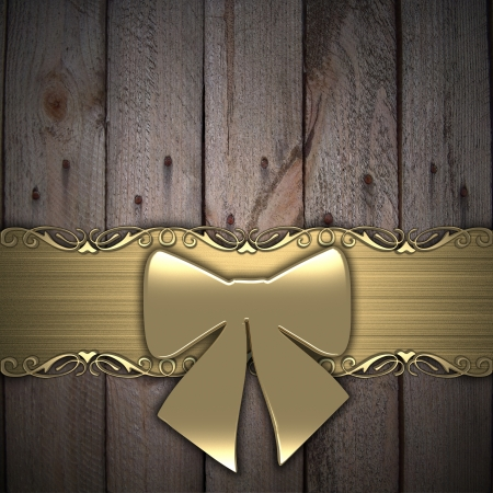 Gift ribbon on wood background  gold  photo
