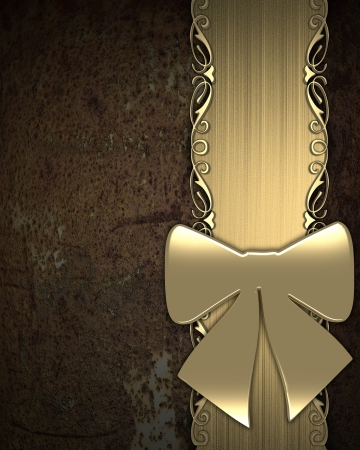 Gift ribbon on rusty background  gold  photo