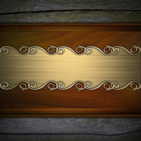 Gold pattern on a gold plate on a wood background photo