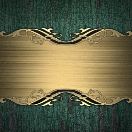 Pattern on a gold plate on a wood background photo