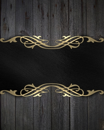Black frame with a gold pattern on a wooden background photo