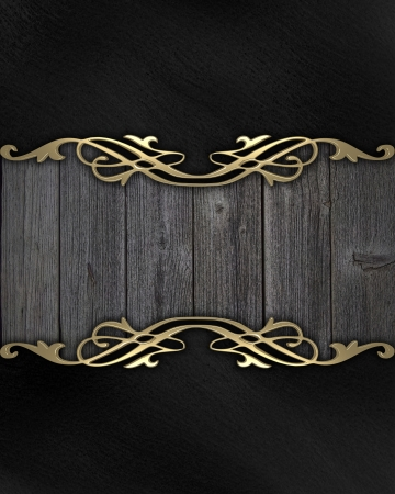 Wooden frame with a gold pattern on a black background photo