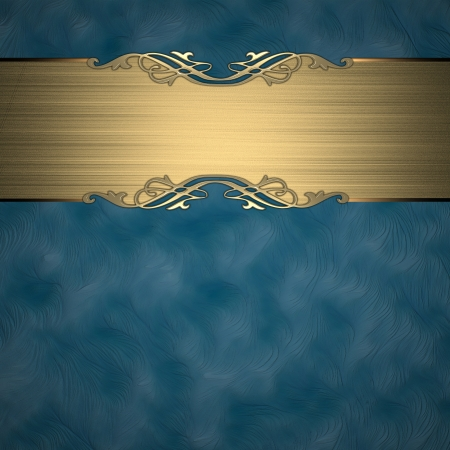 Pattern on a gold plate on a blue background photo