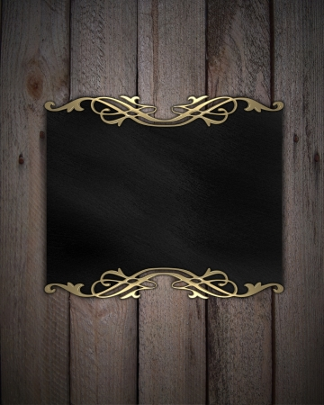 Pattern on a Black plate on a wood background photo