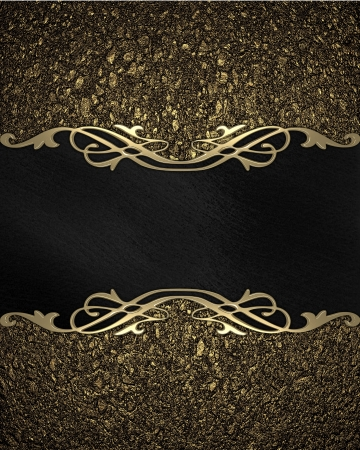 Pattern on a Black plate on a gold background photo