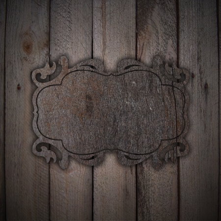 Wooden plate on a wood background photo